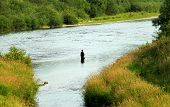pic of atonement  - A man fly fishing in the river in Slovakia - JPG