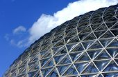 pic of geodesic  - Geodesic dome construction with blue sky and clouds - JPG