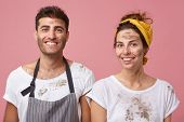 Studio Portrait Of Smiling Man And Woman In White T-shirts Being Dirty After Cleaning Their Apartmen poster