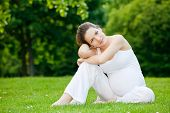 image of pregnant woman  - Beautiful pregnant woman relaxing in the park - JPG