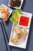 foto of lumpia  - spring rolls with tempura and sauce - JPG