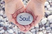 Soul. Woman Holding Stone With The Word Soul In Her Palms. Close Up. poster