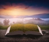 Majestic Spring Scene Of Sunrise In A Alpine Valley On The Pages Of An Open Magical Book. Majestic L poster