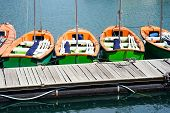 Small Training Sailing Boats At The Pier. Several Small Tourist Boats Standing In Row At A Pier On A poster