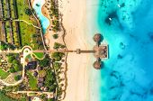 Aerial View Of Beautiful Hotel In Indian Ocean At Sunset poster