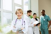 Healthcare People Group. Professional Female Doctor Posing At Hospital Office Or Clinic. Medical Tec poster