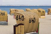 picture of labo  - Hooded beach chairs near Baltic Sea in Germany - JPG