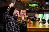 Man In Bar Drinking Beer. Online Communication. Man Bearded Hipster Hold Smartphone. Taking Selfie C poster