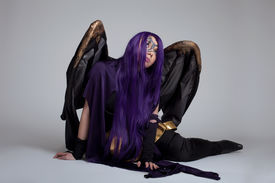 pic of banshee  - girl in purple witch cosplay costume anime character sit portrait - JPG
