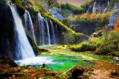 stock photo of crystal clear  - Waterfall in forest - JPG