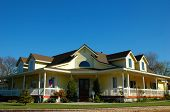 picture of wrap around porch  - country style home in a neighborhood - JPG