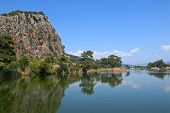 foto of dalyan  - The rock blue sky and green trees glassed in the water of Dalyan river  - JPG