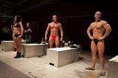 Bodybuilders Posing Before A Body Painting Session At Milano Tattoo Convention