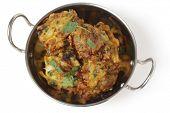pic of kadai  - Homemade onion bhaji Indian appetisers in a kadai serving bowl - JPG