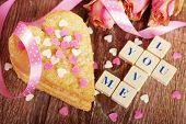 foto of scrabble  - I love you made of scrabble letters dried roses and heart shaped cookies with sprinkles for valentine on wooden table - JPG