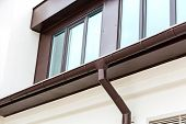 pic of downspouts  - Rain gutter and downspout on the house