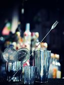 pic of over counter  - Bartender tools at the club over dark background  - JPG