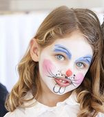 picture of face painting  - portrait of a pretty caucasian girl with blue eyes with her face painted as a bunny rabbit - JPG