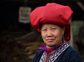 foto of traditional attire  - Woman from Red Dao minority group wearing traditional attire and headdress at Giang Ta Chai village - JPG