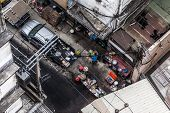 pic of peddlers  - poor hawkers frying food in a crossroads of bangkok thailand - JPG
