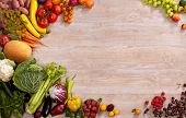 foto of nutrients  - studio photography of different fruits and vegetables on wooden table - JPG