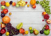picture of nutrients  - studio photography of different fruits and vegetables on wooden table - JPG