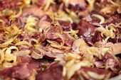 stock photo of liver fry  - Closeup of chicken liver being roasted in the frying pan with white onions - JPG