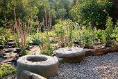 stock photo of naturalist  - Building new gravel terrace with patch of perennials by early morning - JPG
