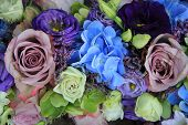 stock photo of centerpiece  - Blue hydragea and purple roses in a blue purple wedding bouquet and centerpieces