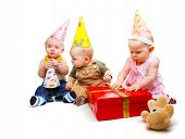 picture of party hats  - Three lovely toddlers in the party hats - JPG