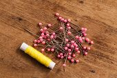 picture of thread-making  - The wood Background with many colored thread - JPG