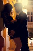 stock photo of prostitute  - Man and woman kissing at night on the street