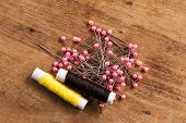 stock photo of thread-making  - The wood Background with many colored thread - JPG