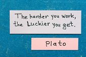 foto of interpreter  - famous ancient Greek philosopher Plato quote interpretation with sticky notes on vintage carton board about hard work - JPG