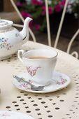 picture of darjeeling  - Afternoon tea served in vintage floral mismatched cups and saucers - JPG