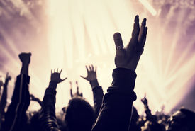 image of life events  - Grunge style photo of silhouette of people hands raised up on musical concert - JPG
