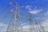 foto of transmission lines  - Electrical transmission tower under clear sky - JPG