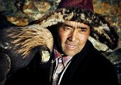 stock photo of mongolian  - Mongolian man with traditional lifestyles - JPG