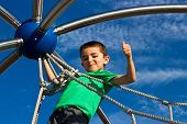 image of jungle  - Proud little boy climbs the jungle gym at the park - JPG