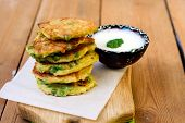 foto of patty-cake  - Courgette and pea patties on board with yogurt - JPG