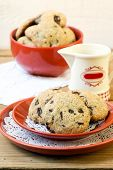 stock photo of skinny fat  - Skinny low fat chocolate chip cookies on plate - JPG