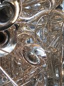 pic of trombone  - Many brass horns in a tangle - JPG