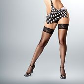 image of fetish fishnet stockings  - Sexy long muscular female legs in high heels - JPG