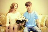picture of sweethearts  - Young man giving flowers to his sweetheart - JPG