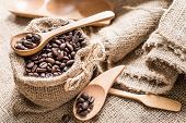 stock photo of coffee coffee plant  - Coffee beans in coffee bag made from burlap on Sack surface - JPG