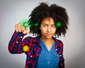 image of wacky  - A mixed race teenage girl with wacky afro hair playing a virtual game in the air in front of her isolated against a grey background - JPG