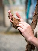 foto of archer  - hand leather archers bands in medieval enironment - JPG