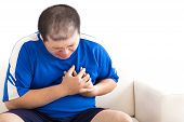 picture of obese man  - young fat man getting heart attack on sofa - JPG