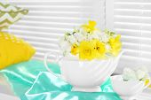 picture of daffodils  - Beautiful bouquet of yellow daffodils and roses in teapot on windowsill - JPG