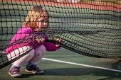 picture of crawling  - Little girl crawling under the net on the tennis court - JPG